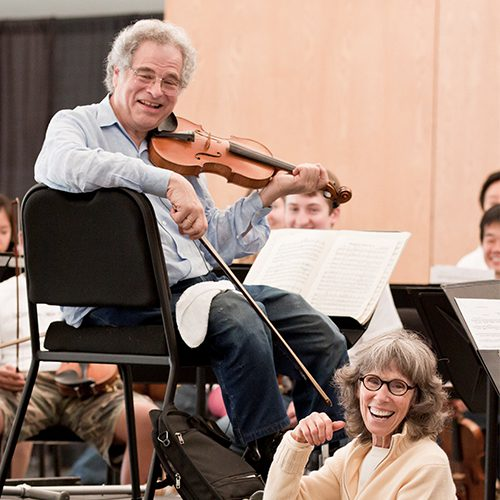 Image of Itzhak and Toby Perlman during a winter recital at USF Sarasota-Manatee campus (photo by Rod Millington)