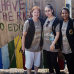 Image of Jody McBrien, PhD, works with volunteers at the Ritsona Refugee Camp in Greece.