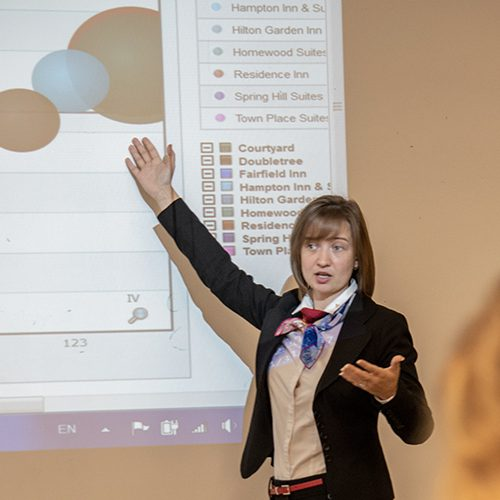 Image of person giving a talk