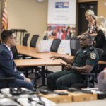 USF Sarasota-Manatee campus student talks to a police officer