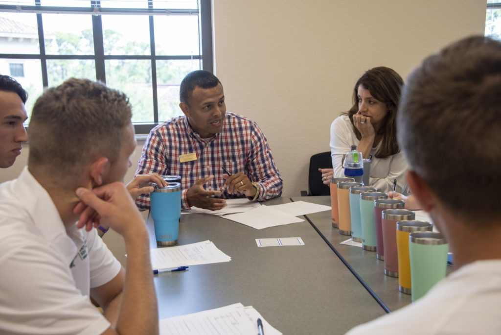 USF Sarasota-Manatee campus students talk together in a classroom
