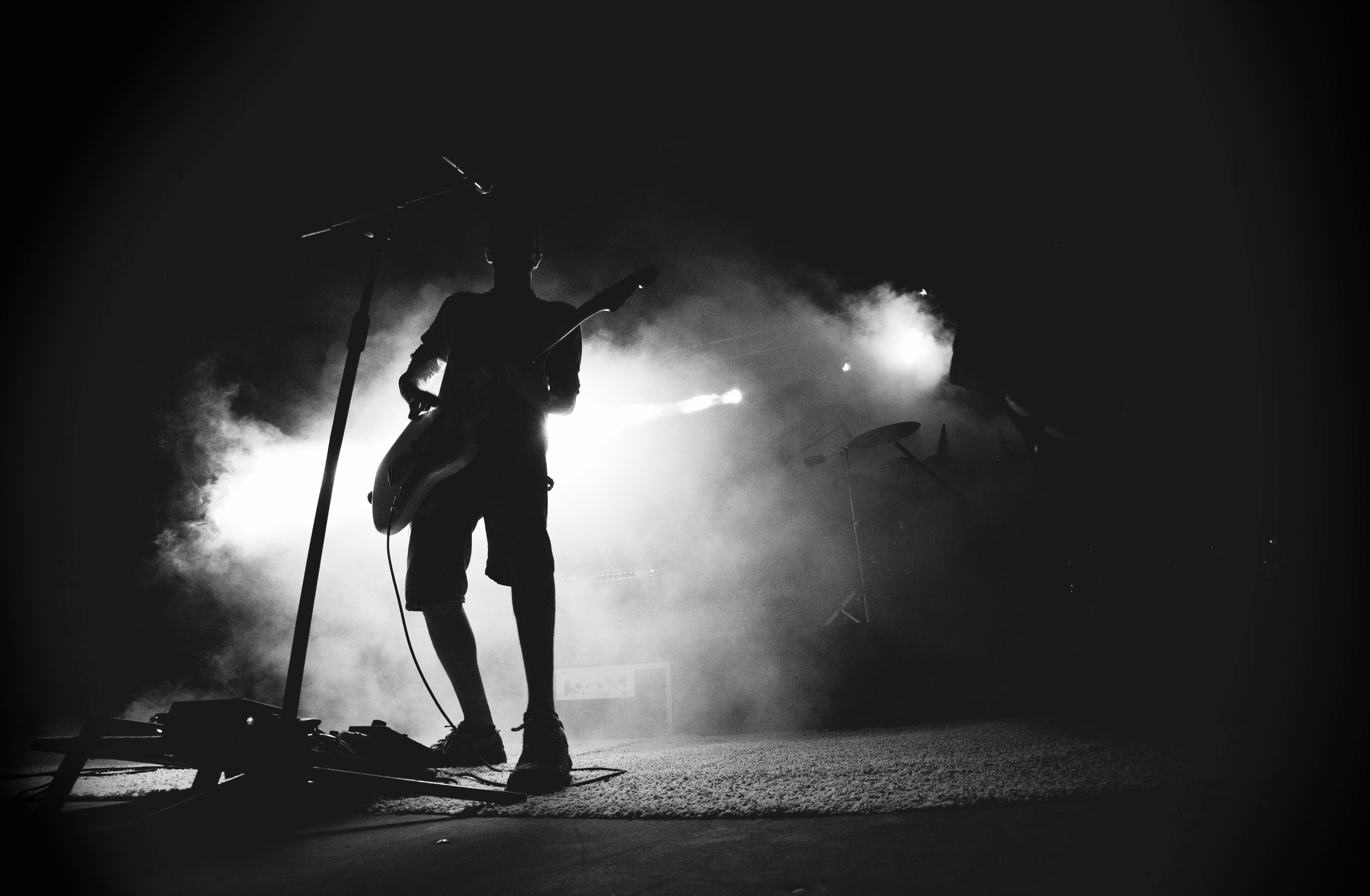 Person playing guitar on stage